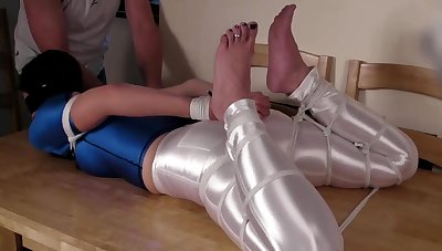 Sexy Girl Hogtied in Colourless Spandex Disco Jeans and Lycra Shirt