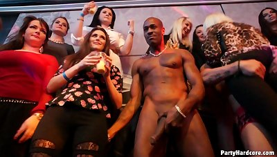 Group sex during a large party with clothed females and male strippers