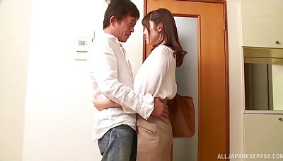 Iioka Kanako drops on her knees to give a wringing wet blowjob to her supplicant