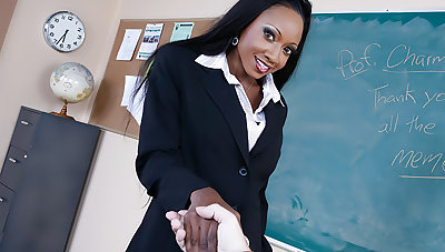 Diamond Jackson takes a big flannel in a classroom