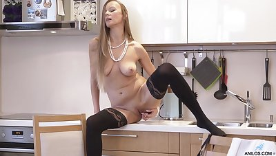 Wearing stockings coupled with masturbating in be passed on kitchen is what gets Devina off